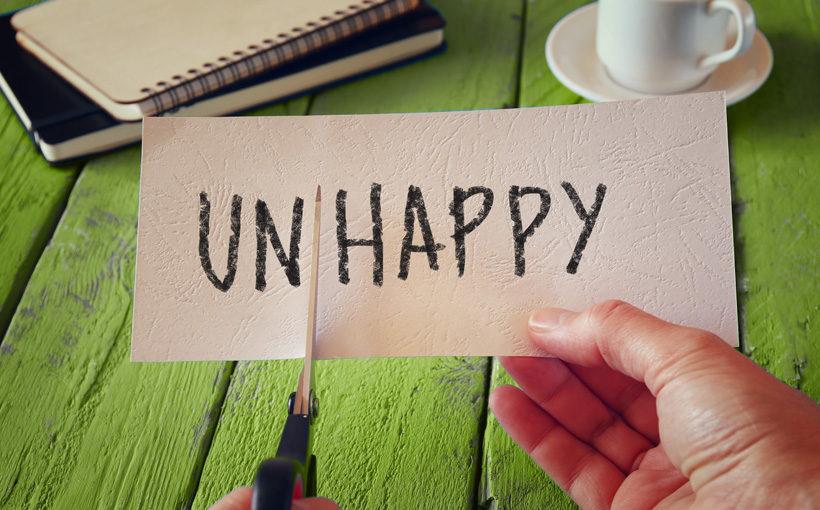 """Schild """"Un/happy"""""""